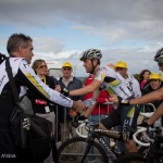 At the finish of stage 4 atop the Mur-de-Bretagne. HTC soigneur passes out drinks to Danny Pate of the U.S. and Matt Goss of Australia.