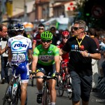 Stage 12 start in Cugnaux, France. Mark Cavendish and his handler make their way to sign-in.