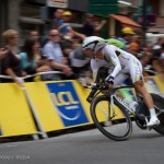 Stage 20 in Grenoble, France. Eventual stage winner Tony Martin takes the final turn at maximum speed.