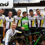 "Stage 21 of the Tour - Paris, France. The HTC team gather around green jersey winner, Mark Cavendish and his special ""green"" Venge from Specialized."